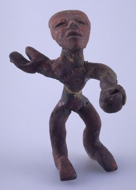 Dancer figurine with stick body and outstretched arms