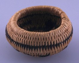 Basket with three miniature baskets inside