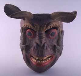 Mask of two horned animal