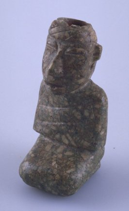 Seated figure with hole in top of head