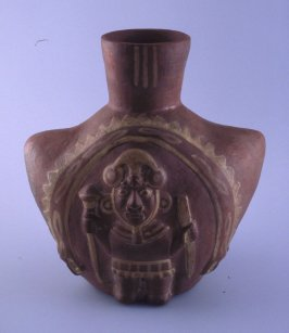 Vessel with fanged deity
