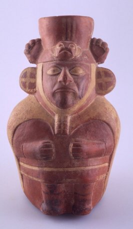 Vessel in the form of a seated male with tall hat