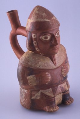 Vessel with stirrup spout in form of standing male