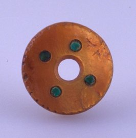 Bead with four green dots