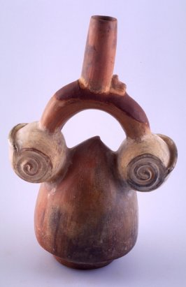 Stirrup spout vessel with two seashells