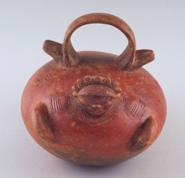 Double spouted vessel