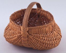 Small basket with round bottom and loop handle