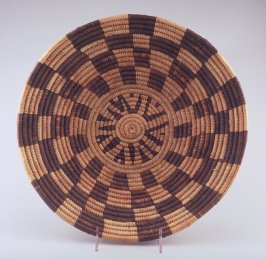 Coiled basket with raised center and brown squares