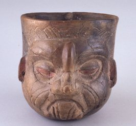 Effigy bowl of Old Man with glyphs