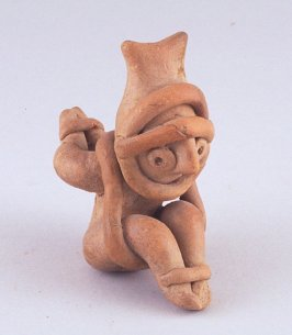 Whistle in the form of a seated figure with hands bound behind back