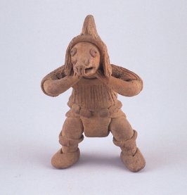 Whistle in the form of a standing figure with helmet