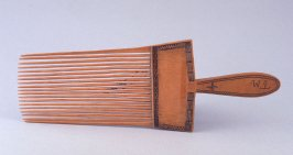 "Man's ornamental comb inscribed, ""T.M."""