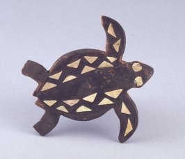 Turtle-shaped breast ornament