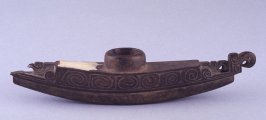 Boat-shaped betel nut mortar