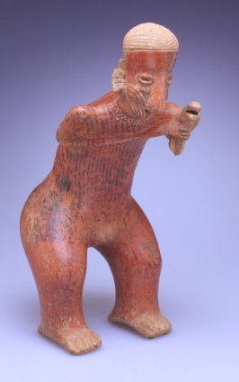 Standing male figure holding rasp