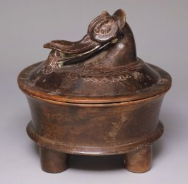 Tetrapod lidded vessel with Muscovy duck