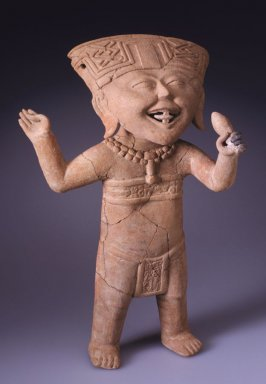 Standing smiling figure holding a rattle