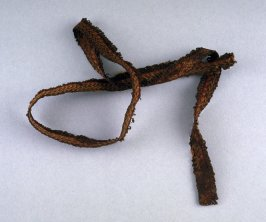 Piece of woven cloth band-shaped