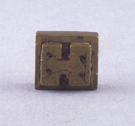 Goldweight with triangle and diamond designs