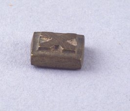 Goldweight with raised X shape