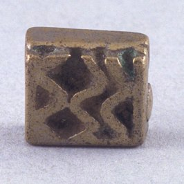 Goldweight with wavy lines