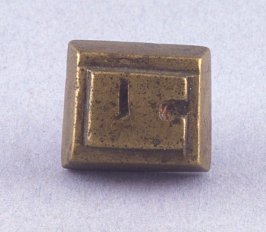 "Goldweight with double ""Y"" design"