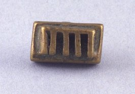 Goldweight in comb shape