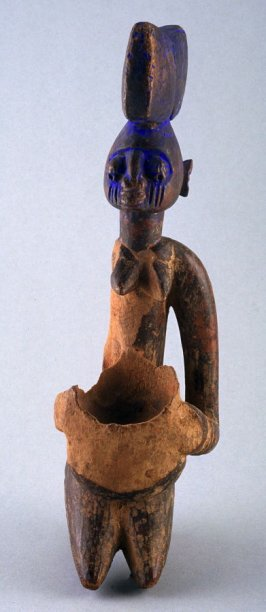 Kneeling female figure with Shango Headdress