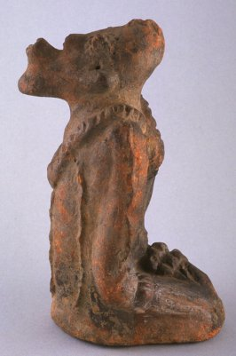 Kneeling figure, dual aspect