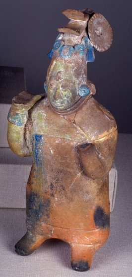 Standing female dignitary in the form of a whistle