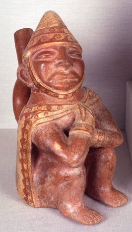 Stirrup spout vessels of seated figure
