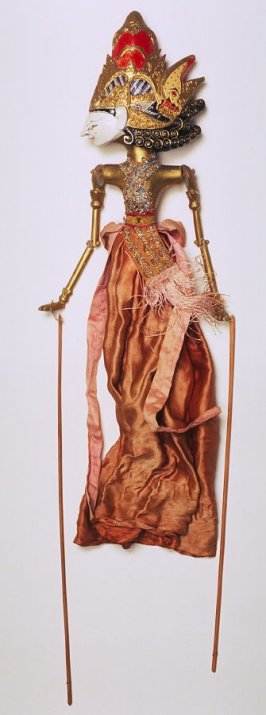 Puppet (head detached) with white face, gold and red helmet, brandy-colored skirt