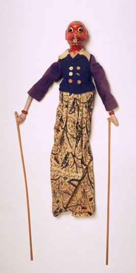 Puppet with red devil's face, blue skirt and patterned skirt
