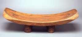 Stool with three legs and curved seat