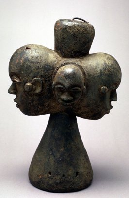 Carved wooden figure with four heads