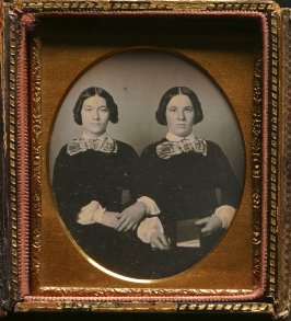 Untitled (Two identically dresssed sisters)