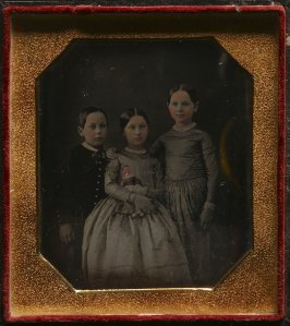 Untitled (Brother and two sisters, one holding a doll)