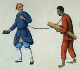 A policeman leading a man in chains