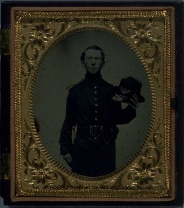 Union Soldier Holding Hat