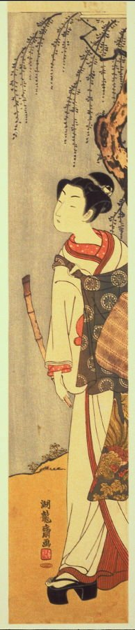 Woman Holding Bamboo Flute