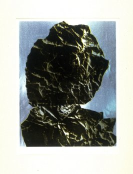 Untitled (rock forms in the shape of a head and shoulders)