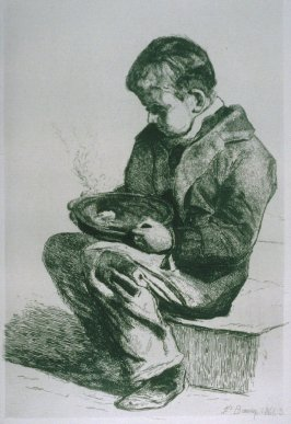 Boy with a bowl of soup