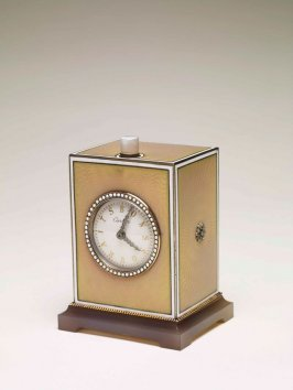 Miniature travelling timepiece