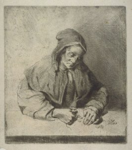 Old woman counting money on a table