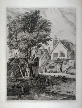 Farmhouse with pond in foreground