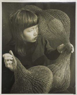 Untitled (Ruth Asawa holding a looped wire sculpture)