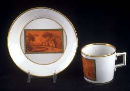 Cup and saucer with rural scene