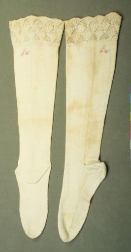 "Pair of stockings : beige, inscribed in red, ""B.E. 7"""