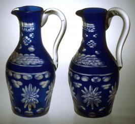 Cruet stand with two blue pitchers and stoppers