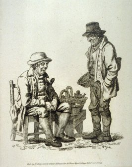 Two men, one selling apples